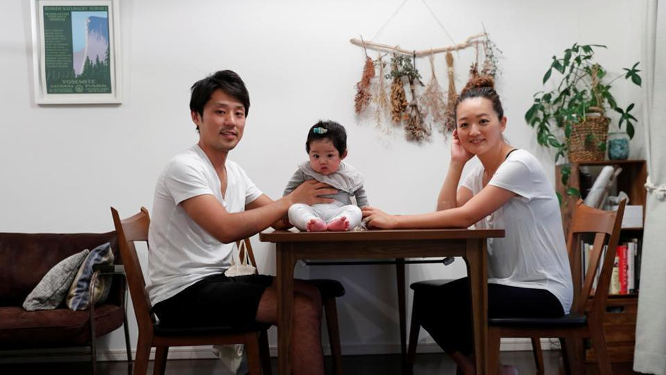 "Eri Sato (R), her husband Tatsuya and three-month-old daughter Sara at their home in Yokohama, Japan. ""I think there's no escaping plastic waste. I see it on the streets, in the mountains, underwater. It's literally everywhere. In our family, we try to reduce our carbon footprint wherever we can. We're very conscious of the impacts our choices can have on the environment, Eri said. (Kim Kyung-Hoon / REUTERS)"