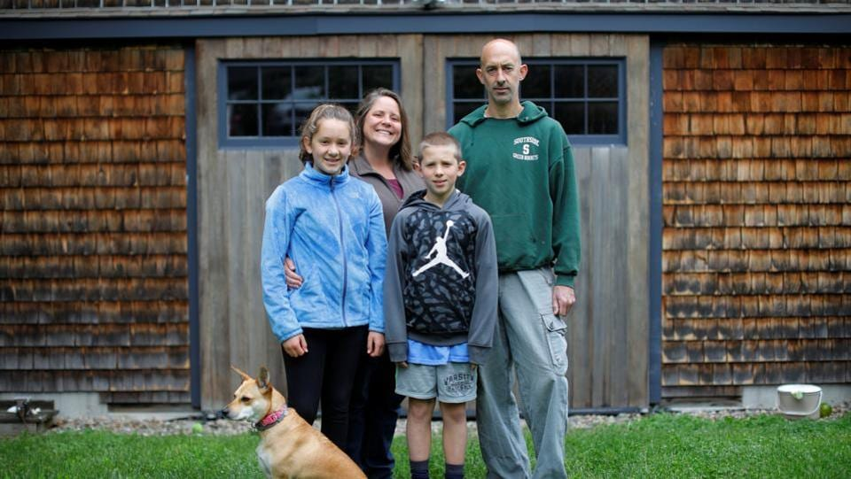 "Brandy Wilbur (2nd L), 44, a high school STEM Coordinator, and Anthony Wilbur (R), 45, a high school environmental science teacher pose for a portrait with their children Sophie (L), 12, and Andrew (2nd R) at their home in Wenham, Massachusetts. ""When shopping, I try to buy products with minimal packaging but that's challenging too as everything is packaged!"" Brandy said. (Brian Snyder / REUTERS)"