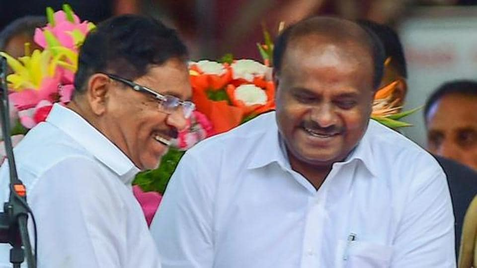 Newly sworn-in Karnataka Chief Minister and JD(S) leader H D Kumaraswamy greets Deputy Chief Minister Dr G Parameshwara after the oath-taking during the swearing-in ceremony of JD(S)-Congress coalition government, in Bengaluru.