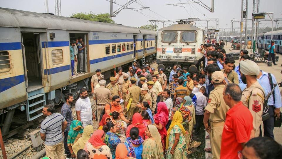 Police remove residents from the Railway colony from a demonstration on the tracks after they stopped a train while protesting over acute water shortage, at Jammu Railway Station. The demonstrators said that due the water shortage has thrown routine life out of gear.  (PTI)