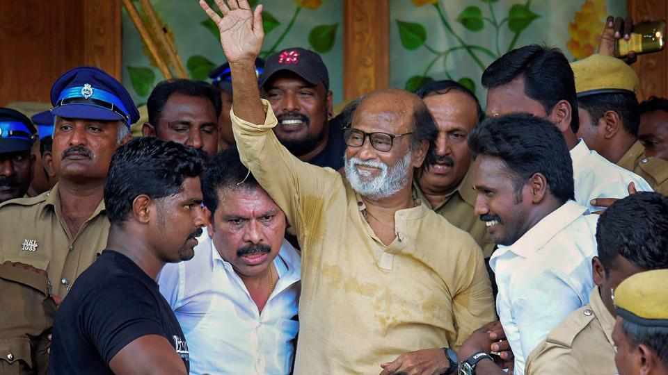 Actor-turned-politician Rajinikanth waves at supporters as he comes out of a government hospital after visiting those who got injured Tuticorin police firing.
