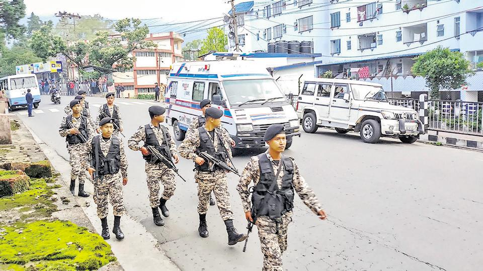 Security personnel patrol a street during curfew, Shillong, June 4, 2018