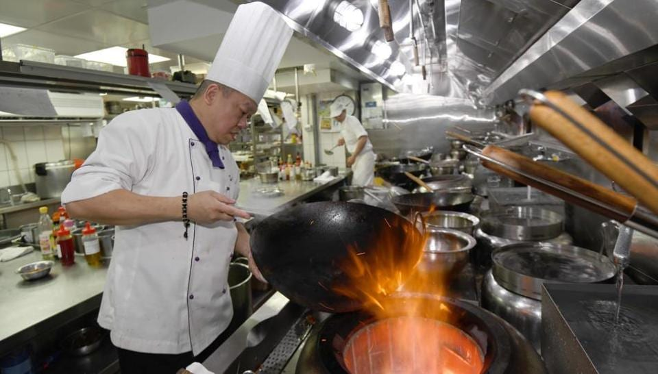 Ken Chan, the executive chef at the five-star hotel restaurant Le Palais in Taipei, demonstrates a cooking technique.