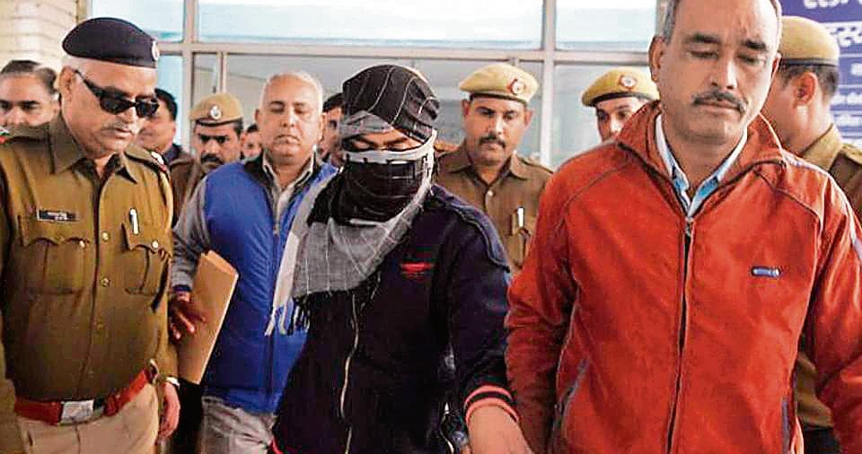 CBI officials produce the accused in the murder case before the Juvenile Justice Board.