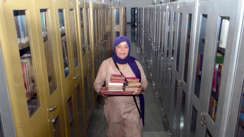 An employee sorting books at Sikh Reference Library at Golden Temple in Amritsar on Tuesday.