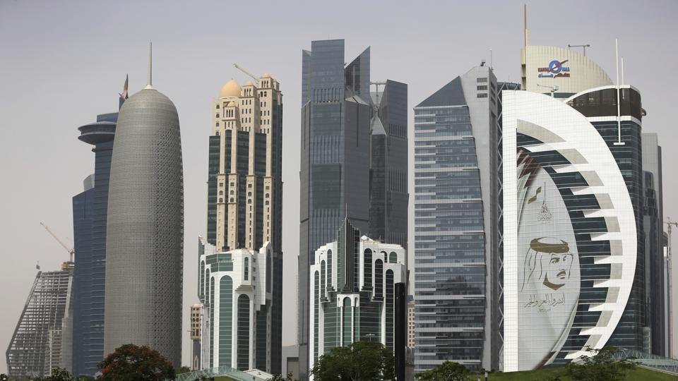 Construction is still underway at some skyscrapers, and at the stadiums being built ahead of the 2022 FIFA World Cup. Portraits of Qatar's ruling emir, 38-year-old Sheikh Tamim bin Hamad Al Thani, are plastered across public places old and upcoming. (Kamran Jebreili / AP)