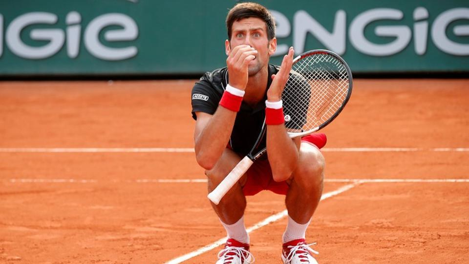 Novak Djokovic appeared distraught after his French Open quarter-final defeat by unseeded Marco Cecchinato.