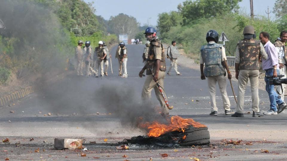 Police patrol the Neemuch highway amid burning tyres of a truck in Mandsaur , Madhya Pradesh, on June 7, 2017.