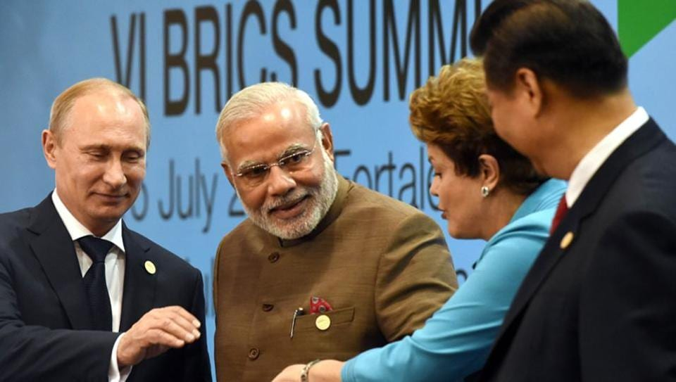 Prime Minister Narendra Modi (centre) poses with Russian President Vladimir Putin (extreme left), Chinese premier Xi Jinping (extreme right) and former Brazilian President Dilma Rousseff at the VI BRICS Summit in July 2014.