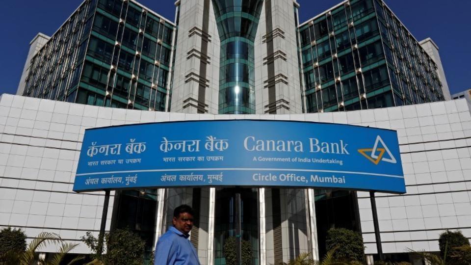 A man walks past a Canara Bank office in Mumbai.