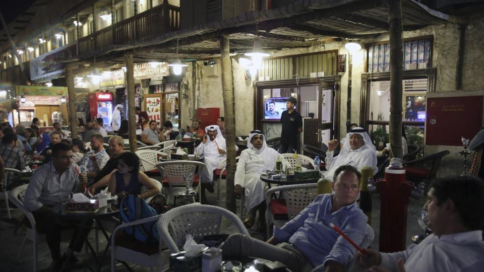 An evening scene at the Waqif Souq in Doha. Daily life has mostly remain unchanged apart from a signs of the boycott here and there — grocery stores once filled with dairy products from Saudi Arabia, which has shut down Qatar's only land border, now stock items from Turkey and Iran. Air routes with the flagship Qatar Airways now route through Oman or over Iranian airspace. (Kamran Jebreili / AP)