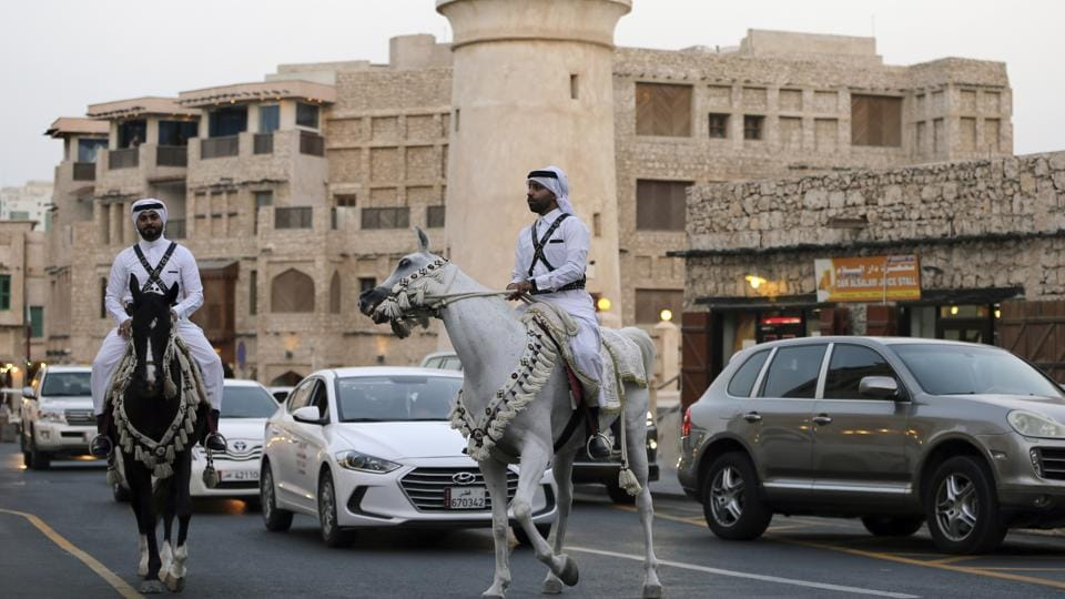 Qatari police officers in national dress, wearing crisscrossing bandoliers, patrol on horseback, a nod to a time before Qatar's vast natural gas wealth when rifle-carrying cavalry defended the emirate. Today, Qatar has a modern military and hosts some 10,000 American forces at the vast al-Udeid Air Base. So far though, this dispute has only been one of words. (Kamran Jebreili / AP)