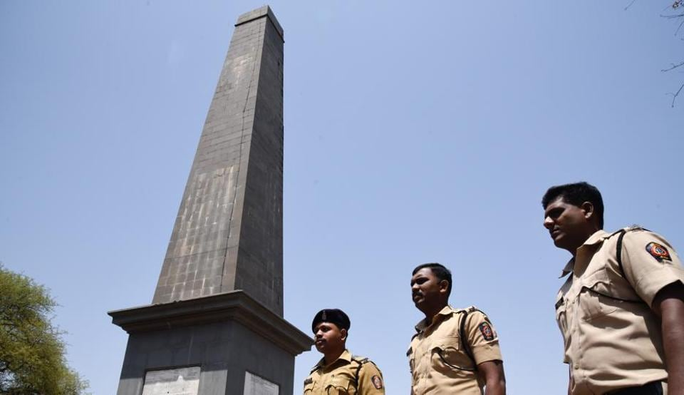 Police officials keeps a watch around the vijay stambha (victory memorial) in Bhima Koregaon in Pune on May 8, 2018. Violence had erupted when Dalit groups were celebrating the bicentenary of the Bhima Koregaon battle in which the forces of the British East India Company defeated the Peshwa's army.
