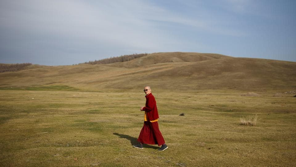 Senior Buddhist monk Lobsang Tayang walks outside the Amarbayasgalant Monastery in Mongolia. Buddhism is one of the world's oldest religions but its fate in Mongolia now rests on young shoulders. The country's monasteries are increasingly run by millennial monks, the first generation to come of age after decades of religious repression under the Soviet system wiped out almost all Buddhist clergy. (Thomas Peter / REUTERS)