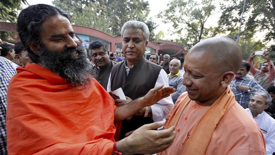 A file photo of Baba Ramdev with Uttar Pradesh chief minister Yogi Adityanath.