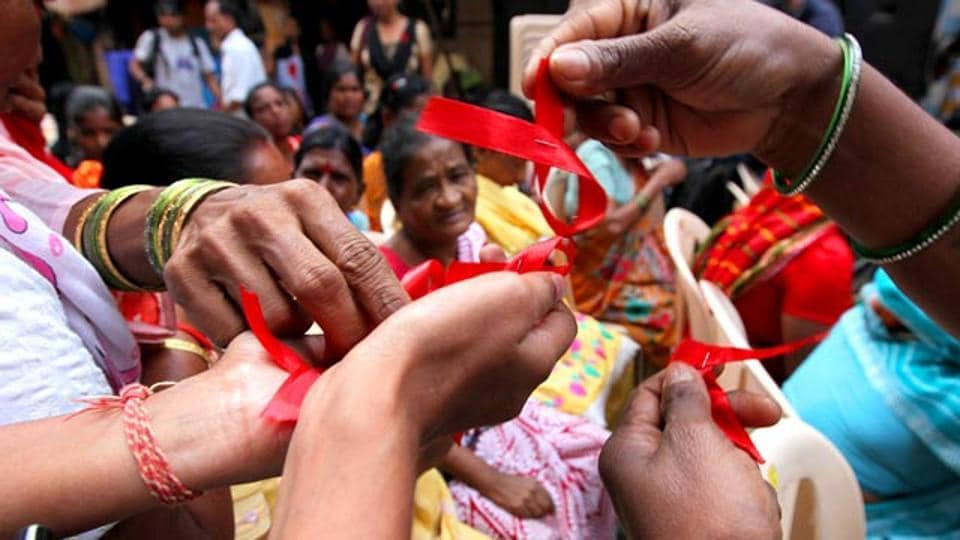 Sex workers distribute red ribbons, symbol of the fight against AIDS, Mumbai (Representative Photo) (Vijayanand Gupta/HT)