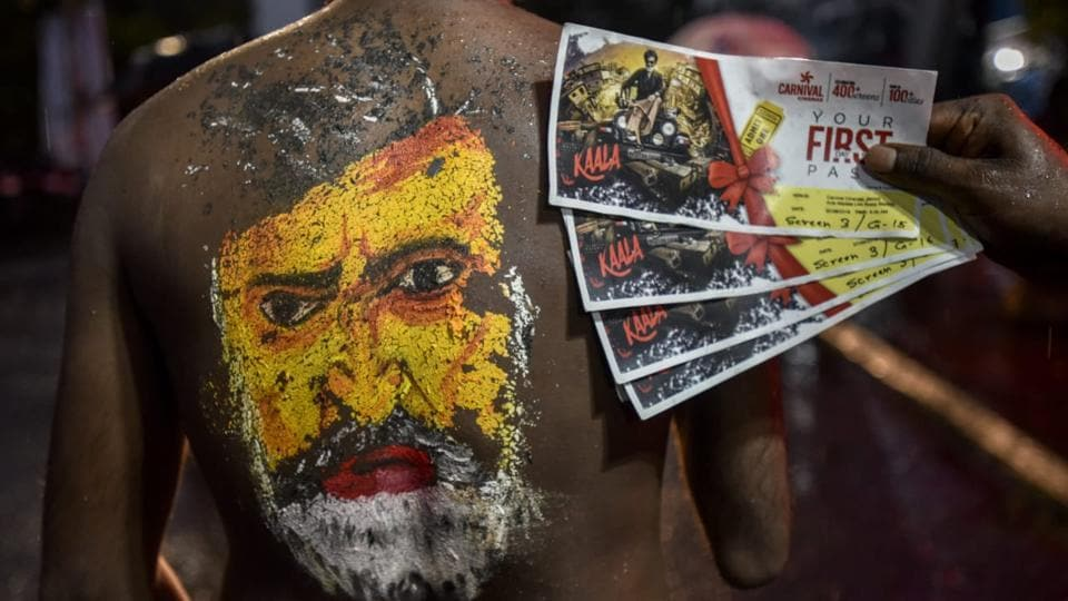 A Rajinikanth fan in Mumbai displays his tickets ahead of Kaala's release in the city.