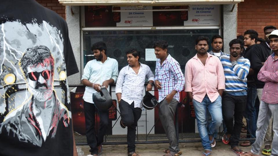Movie goers and fans wait to buy tickets for Rajinikanth's Kaala movie at Balaji theatre in Bengaluru on Thursday. Pro-Kannada groups staged protests outside the theatre, leading to the shows being cancelled.