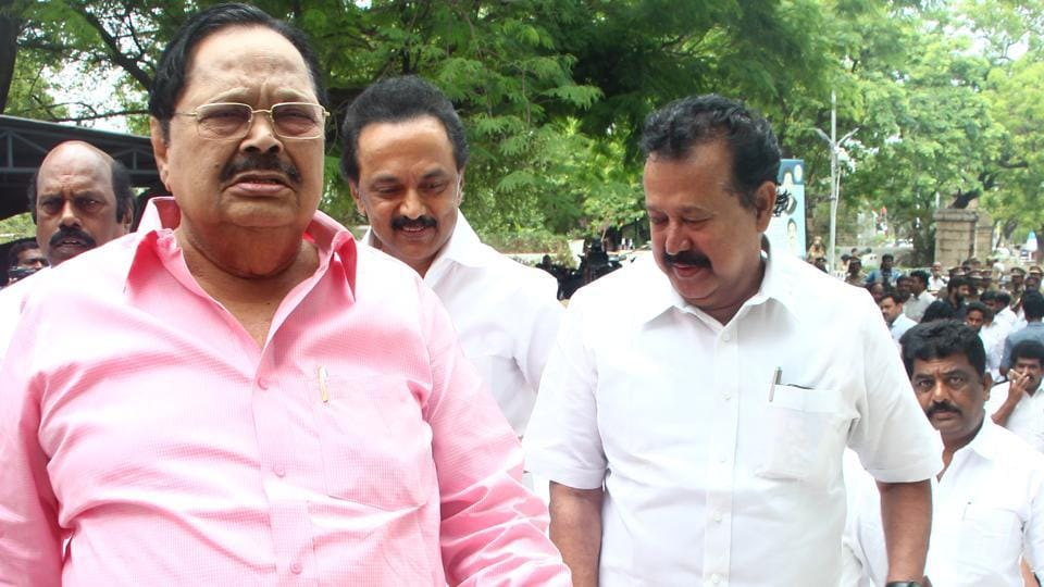 DMK leaders walk out of the assembly on Thursday.