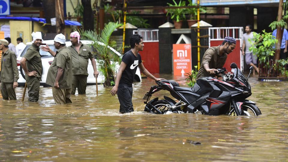 Awaterlogged road near Gurunanak hotel after heavy rains lashed Mumbai on Thursday.