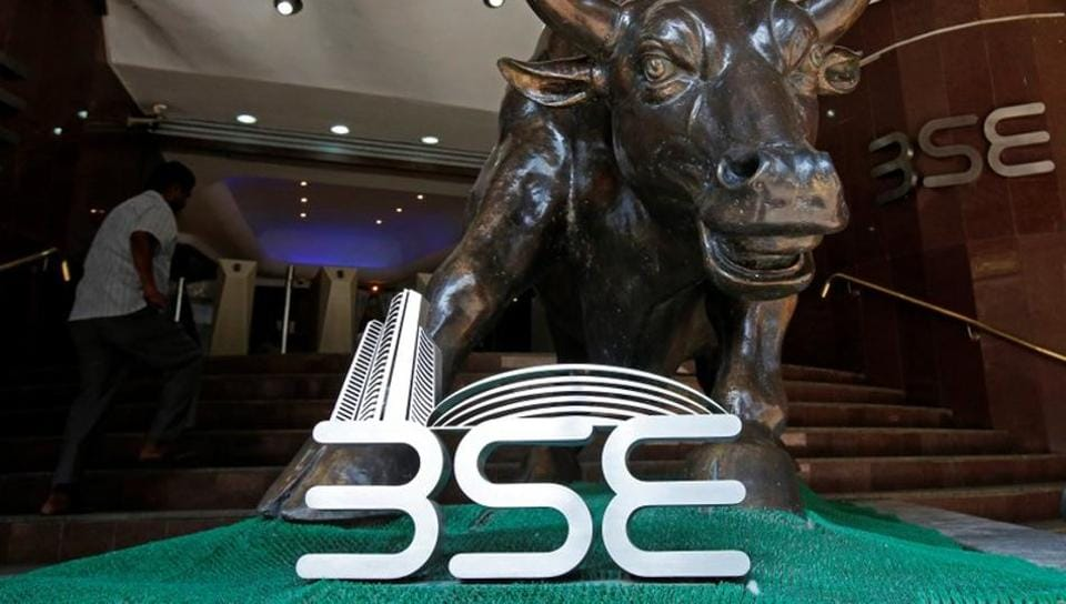 The Bombay Stock Exchange (BSE) logo is seen under a bull statue at the entrance of their building in Mumbai.