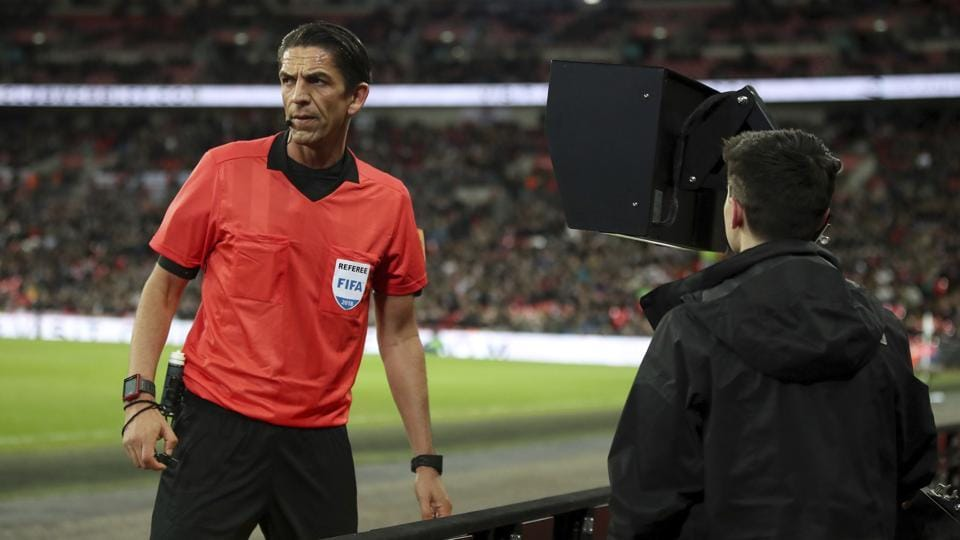 Referee Deniz Aytekin consults the VAR (video assistant referee) before awarding a penalty to Italy during the international friendly soccer match between England and Italy at the Wembley Stadium in London, Tuesday, March 27, 2018. (Nick Potts/PA via AP)