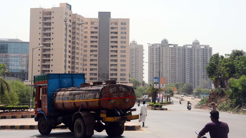 Water Tankers seen supplying water to societies in Kharadi in Pune.