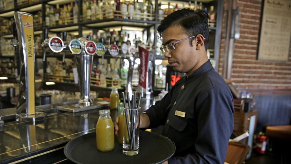 "Some restaurants in and around New Delhi are doing away with plastic straws and replacing them with paper. ""People listen more to children bringing up environmental concerns,"" said Mukarji, who has helped replace more than 500,000 plastic straws at restaurants and hotels since he started his campaign in March. (Altaf Qadri / AP)"