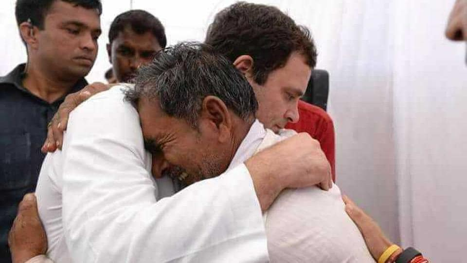 Congress president Rahul Gandhi consoles a family member of a farmer who was killed in police firing during 2017 farmers' agitation, at Kisan Samriddhi Sankalp rally, in Mandsaur, Madhya Pradesh, on June 06, 2018. (HT Photo)