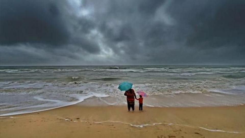 A woman standing with her son at Marina beach following heavy downpour in Chennai.