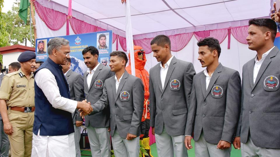 CM Trivendra Singh Rawat meets members of the state police team that scaled Everest, at Police Lines in Dehradun on Friday.
