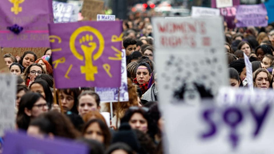 Demonstrators hold placards at the Puerta del Sol square during a one day strike to defend women's rights on International Women's Day 2018 in Madrid. With nearly twice as many women as men in ministerial posts, the new socialist government has emerged from a strong feminist movement that permeates all areas of society and made itself felt in the unprecedented women's strike earlier this year. (Oscar Del Pozo/ AFP File)