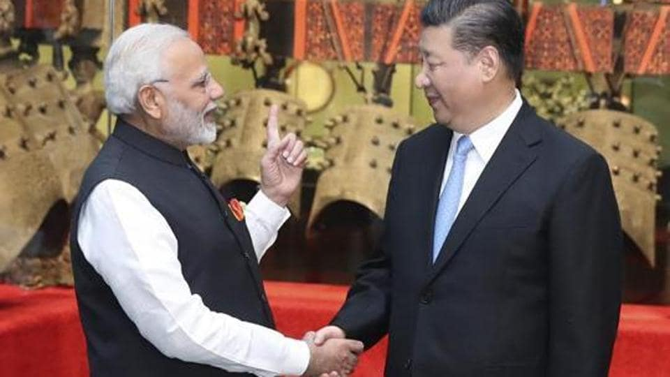 Narendra Modi shakes hands with Chinese President Xi Jinping as they visit an exhibition of cultural relics at the Hubei Provincial Museum in Wuhan in central China's Hubei Province, April 27, 2018.
