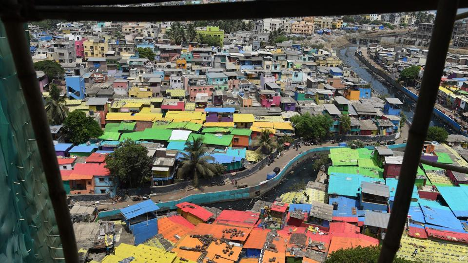 An view from up above shows houses painted in bright colours at a fishing locality in Mumbai, Maharashtra, on June 2, 2018. (Punit Paranjpe / AFP)