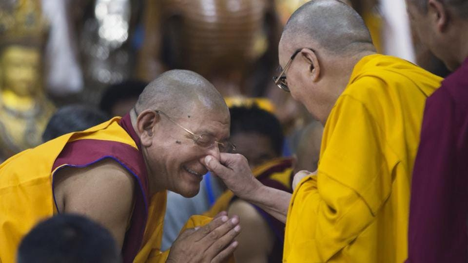 Tibetan spiritual leader the Dalai Lama playfully pinches the nose of a senior monk as he arrives to give a talk to Tibetan youth in Dharamshala, Himachal Pradesh on June 7, 2018. Every year the Tibetan leader speaks to young Tibetans to introduce them to Buddhist precepts. (Ashwini Bhatia / AP)