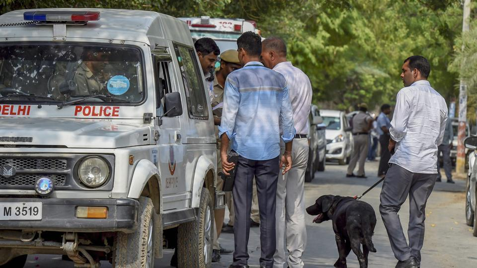 Police personnel and forensic experts inspect the site of an encounter between the Special Cell and a gang of criminals in the Chattarpur area of south Delhi on Saturday.