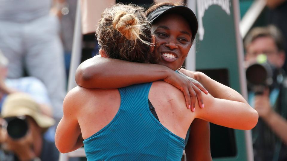 Halep embraces Stephens after winning the final.  (REUTERS)