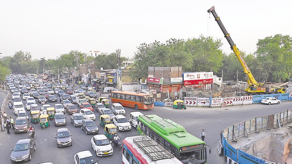 Vehicles stuck in traffic jam during peak hours at Ashram Chowk, in New Delhi.