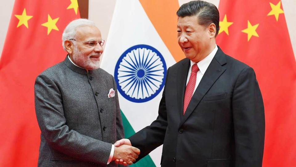 Narendra Modi shakes hands with Chinese President Xi Jinping during the 18th Shanghai Cooperation Organisation (SCO) Summit in Qingdao, China.