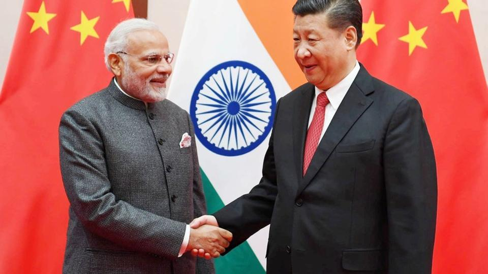 Prime Minister Narendra Modi shakes hands with Chinese President Xi Jinping during the 18th Shanghai Cooperation Organisation (SCO) Summit in Qingdao, China.