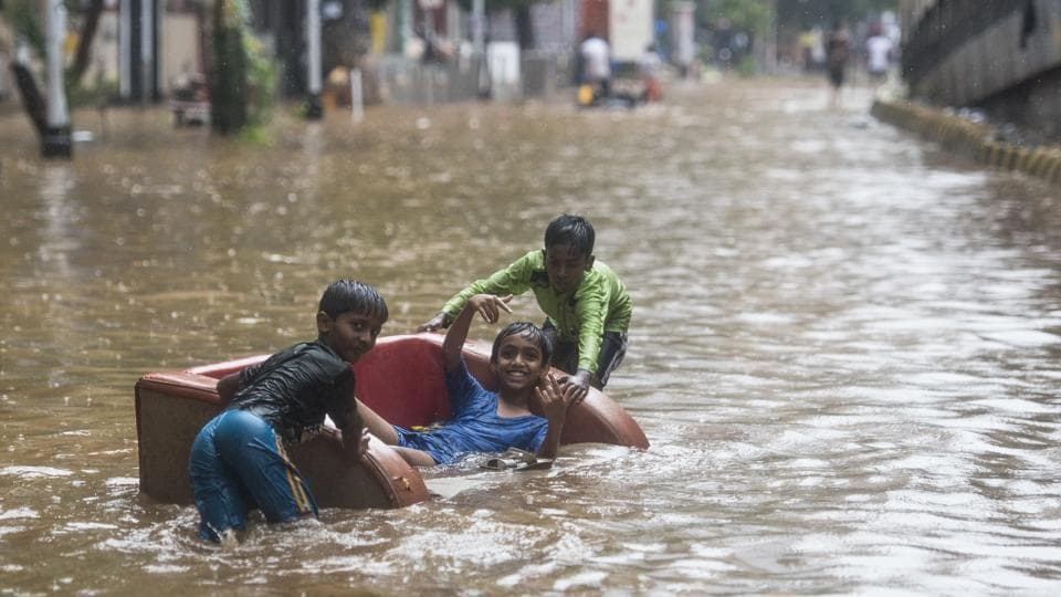 Children play in a waterlogged street after heavy rains at Hindamata, Parel in Mumbai, Maharashtra on June 9, 2018. (Pratik Chorge / HT Photo)