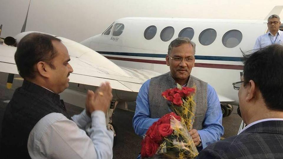 Chief minister TS Rawat usually boards the state plane (in background)  for long distances.