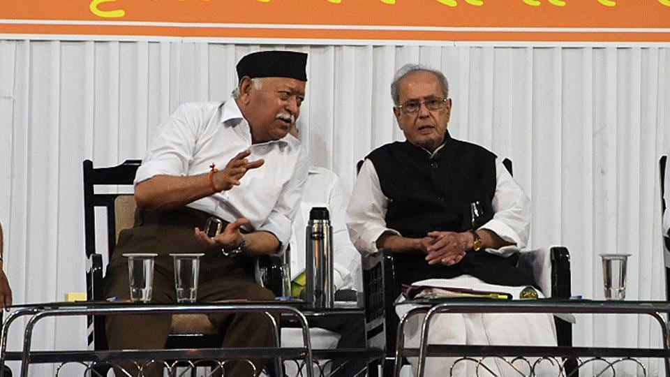 RSSchief Mohan Bhagwat speaks with former president Pranab Mukherjee during an event at the RSS headquarters in Nagpur, on June 7, 2018.