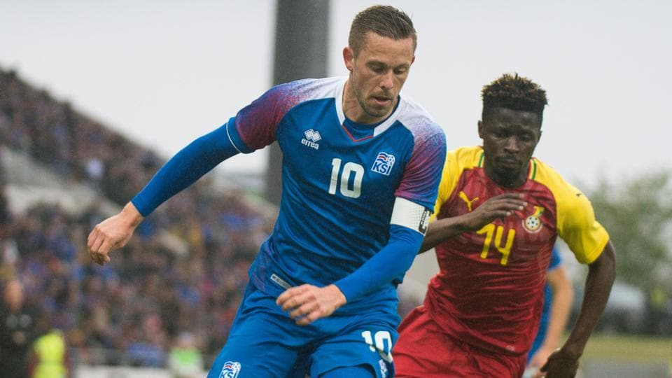 Iceland's midfielder Gylfi Sigurdsson (L) and Ghana's Nana Ampomah vie for the ball during the international friendly football match Iceland vs Ghana in Reykjavik.
