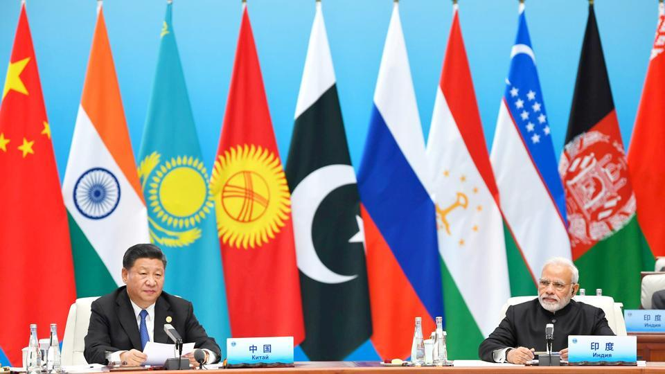 India's Prime Minister Narendra Modi (right) and Chinese President Xi Jinping attend the plenary session of the Shanghai Cooperation Organization (SCO) summit in Qingdao, China, on Sunday.