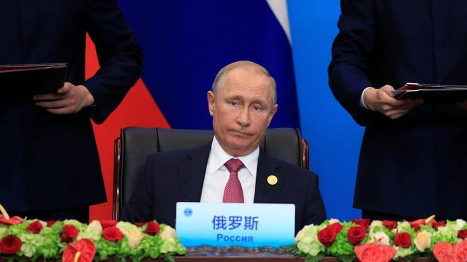 Russia's President Vladimir Putin attends a signing ceremony during Shanghai Cooperation Organization (SCO) summit in Qingdao, Shandong Province, China June 10, 2018.