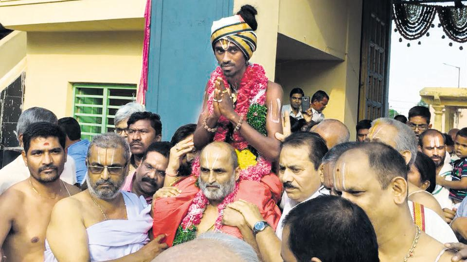 Hyderabad priest CS Rangarajan carrying Aditya Parasari into the Sri Ranganatha temple at Jiaguda on April 16.