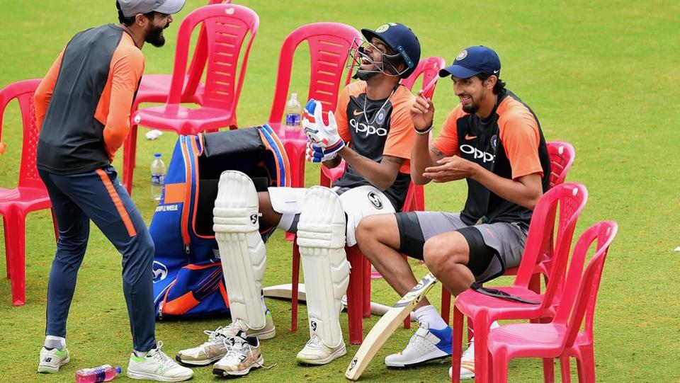Indian cricket team players Ravindra Jadeja, Hardik Pandya and Ishant Sharma share a light moment during a practice session ahead of their maiden cricket test match against Afghanistan in Bengaluru. Afghanistan will become just the 12th nation to play Test cricket when they take on India on Thursday. (Shailendra Bhojak / PTI)