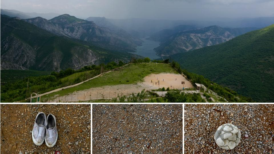 An open clearing surrounded of mountains in the village of Gurgurnica, 35 km away from the nearest city of Tetovo, Macedonia is shared by a basketball court, and an improvised football pitch. A tattered ball and shoes that are fraying don't mean a game can't be played.  (Ognen Teofilovski / REUTERS)