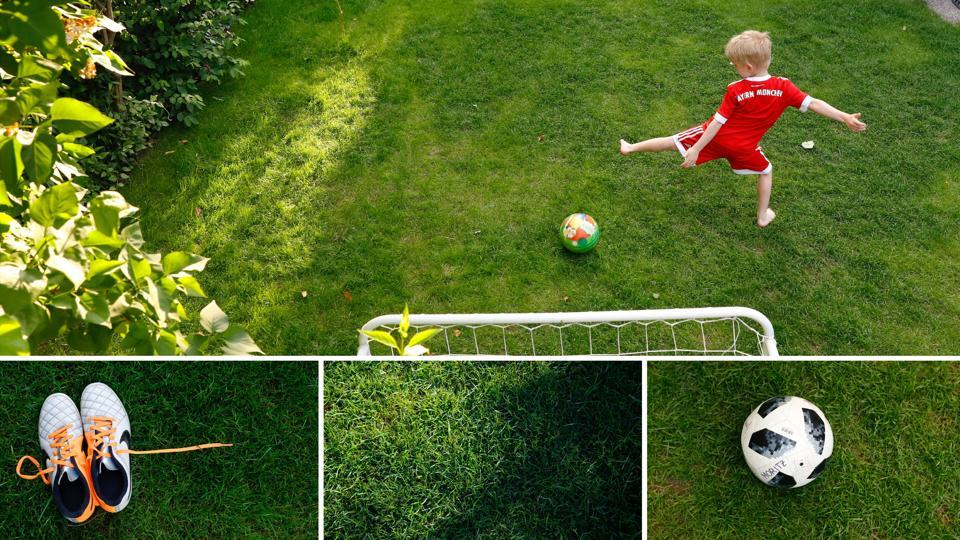 A boy plays soccer in a backyard garden in Vienna, Austria. On a floating pitch off the coast of Thailand or this prim garden with its own goalpost, football fever sweeps hearts and minds around the world. (Leonhard Foeger / REUTERS)